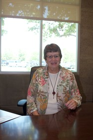 Mary Hornbuckle in her office at the Coast Community College Board of Trustees District Office.