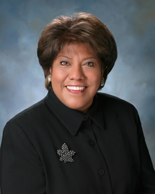 Professional portrait of Rose Espinoza.